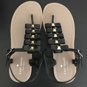 kate spade ♠️ black & gold jelly bow stud sandals